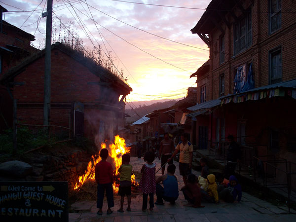 Charring a sacrificed buffalo in the village of Changu at sunrise