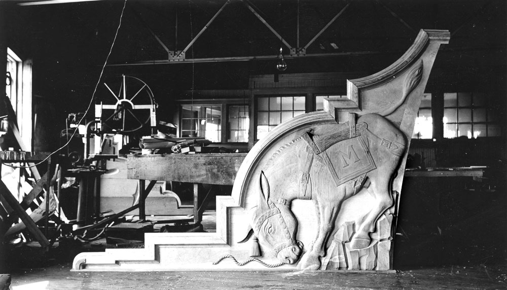 "1937 Steinhauer Field House The architect who designed the Field House (""Steinhauer"" was added to the name in 1949), incorporated a bucking burro and other imagery into the terra cotta castings placed at either end of the building. He was later asked to incorporate these into graphics for the school's first logo. (Photo: Russell & Lyn Wood Mining History Archive, Arthur Lakes Lib., CSM)"