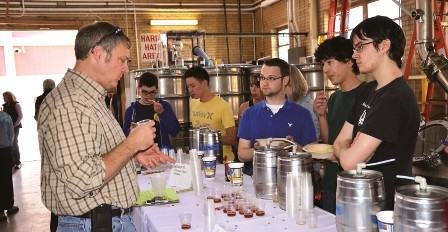 "Students from the ""Introduction to Brewing Science"" class at Mines await the verdict as Pete Turner '90, MS '94 tastes the team's crafted beer. Turner is a manufacturing systems engineer and sensory panelist at MillerCoors."