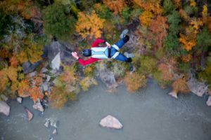 An above shot of Chris Fehn getting ready to pull his parachute above the New River Gorge.
